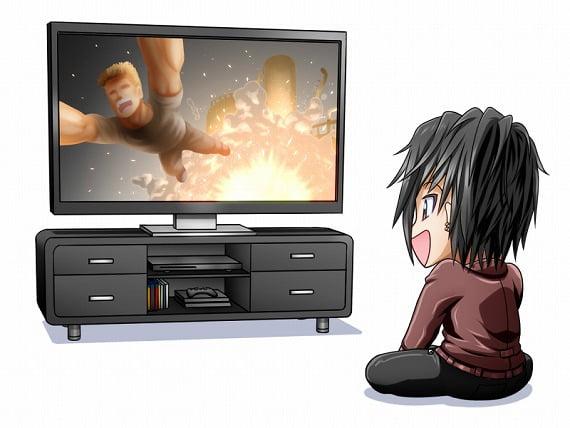 映画を見ている少年