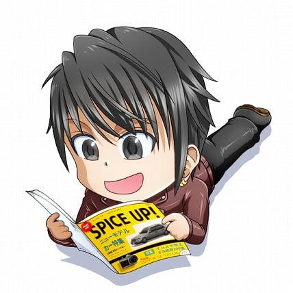 寝ながら雑誌を読んでいる男の子